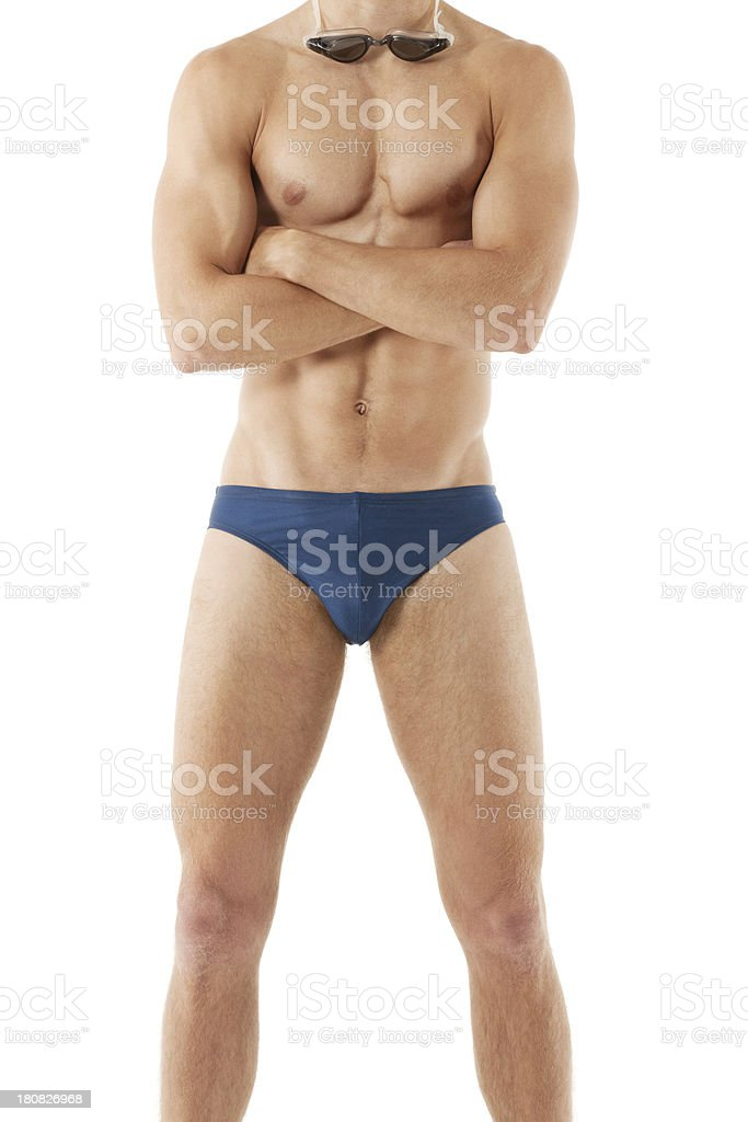 Muscular man standing with arms crossed royalty-free stock photo