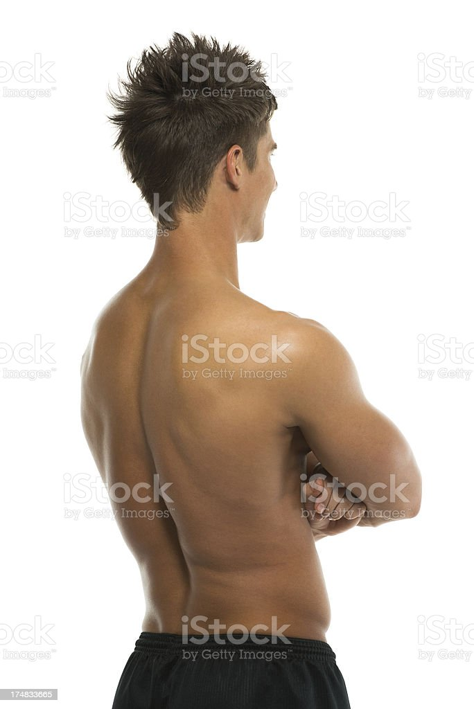 Muscular man standing with his arms crossed royalty-free stock photo