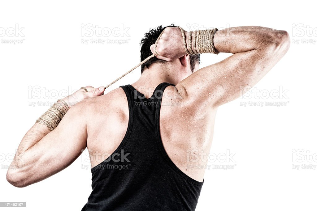 Muscular Man tied with rope royalty-free stock photo