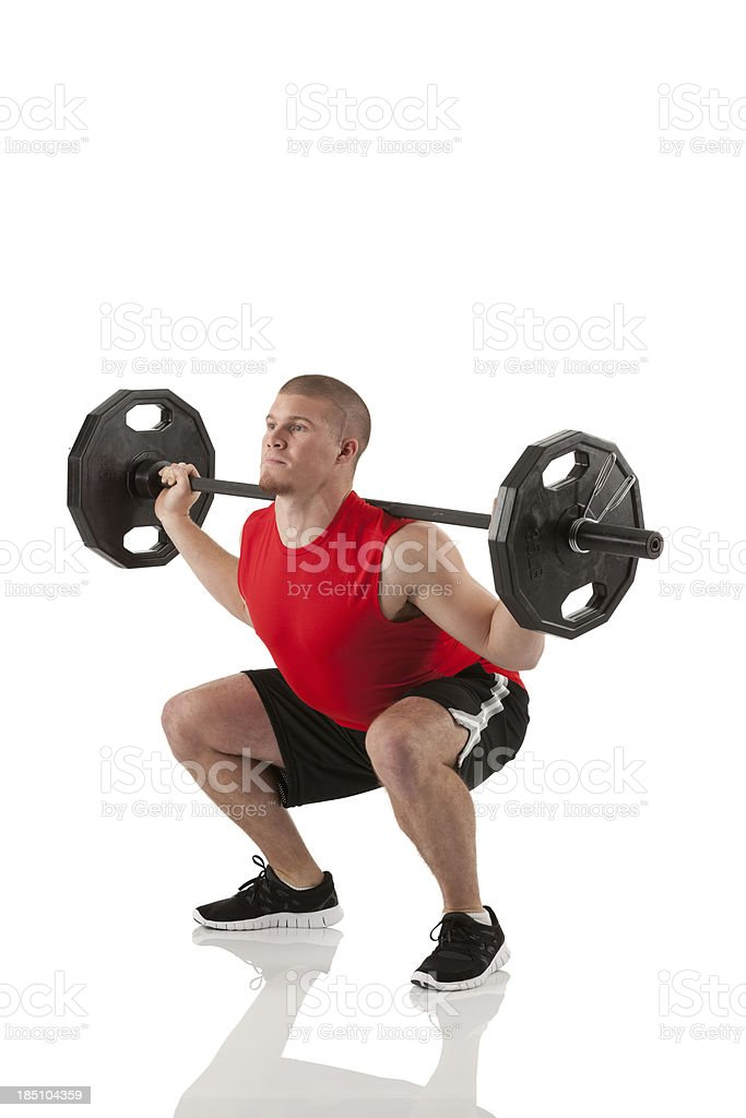 Muscular man weightlifting stock photo