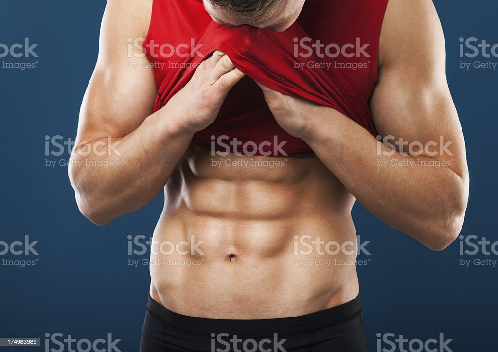 Muscular man wiping off sweat royalty-free stock photo