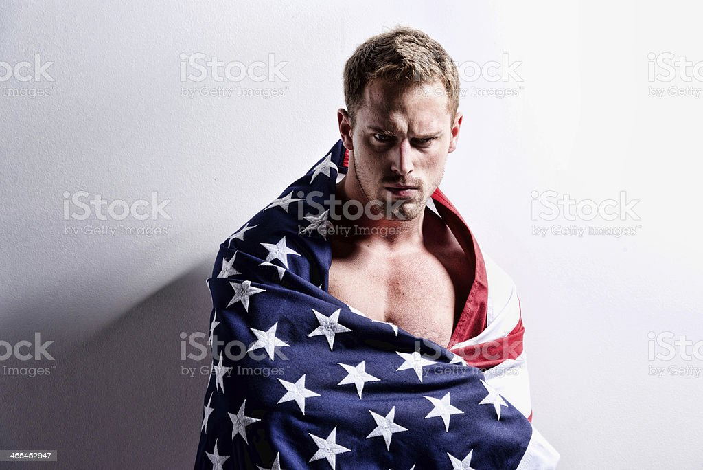 Muscular man with American flag royalty-free stock photo
