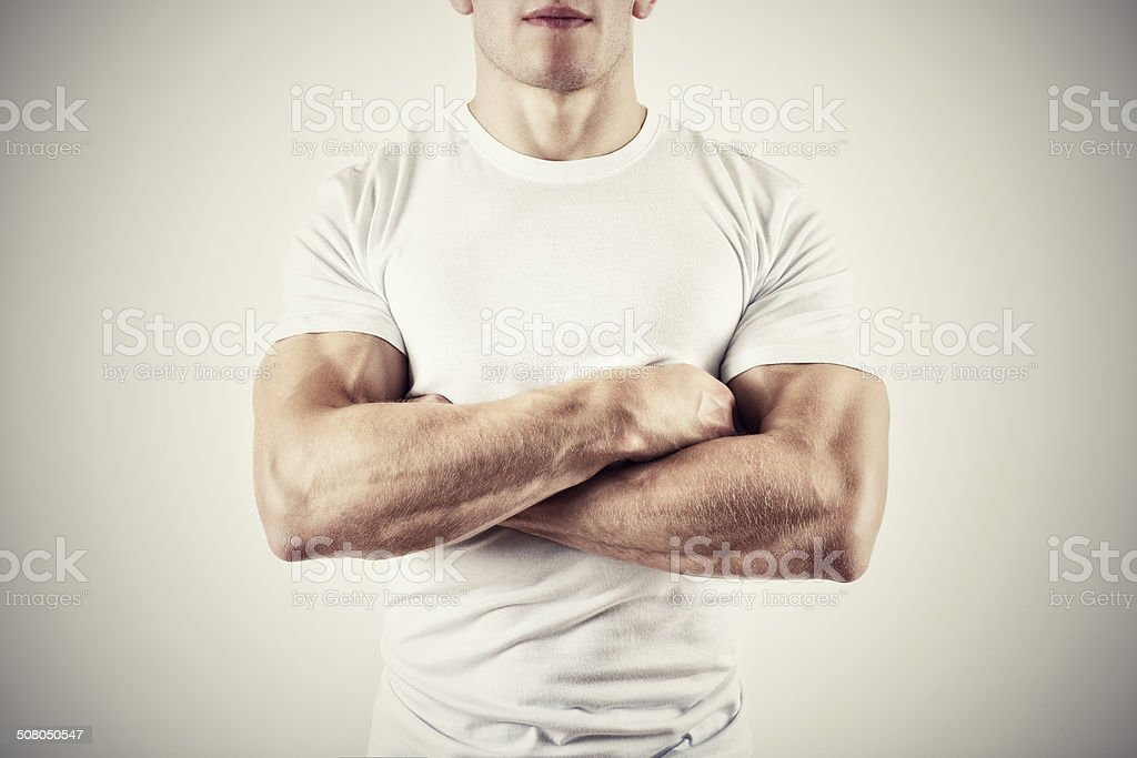 Muscular Man with Arms Folded. stock photo