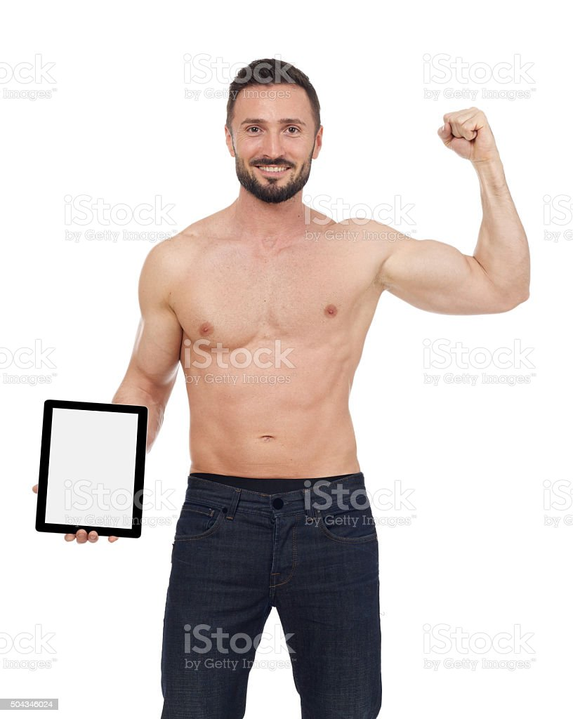 Muscular man with digital tablet stock photo