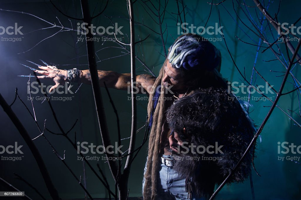 Muscular man with dreadlocks and skin through stock photo