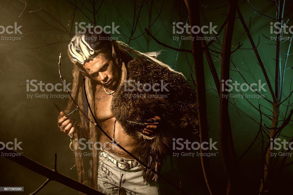 Muscular man with dreadlocks stock photo