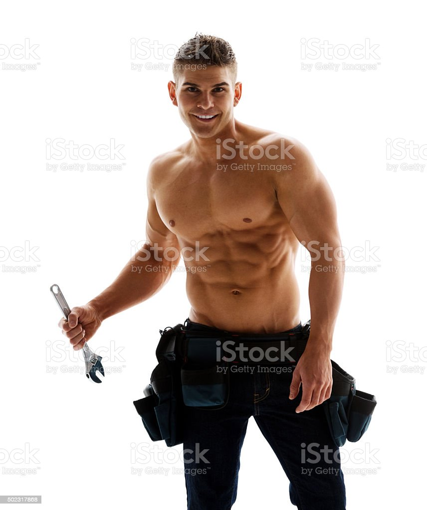 Muscular man with his tools stock photo