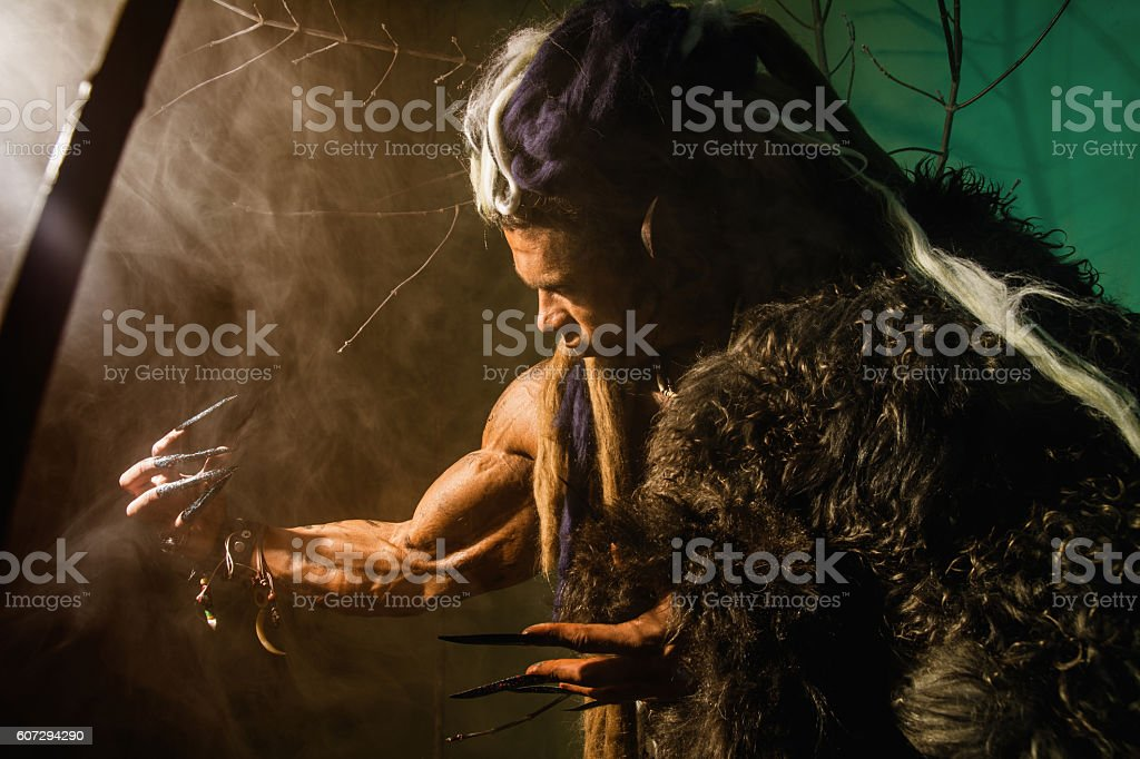 Muscular man with skin and dreadlocks stock photo
