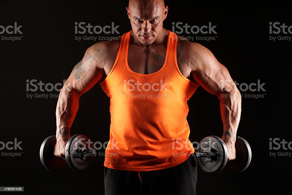 muscular man with weights stock photo