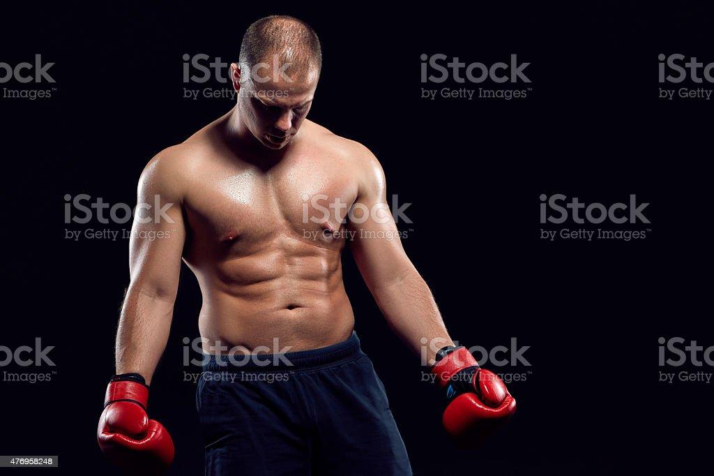 Muscular man - young caucasian boxer stock photo