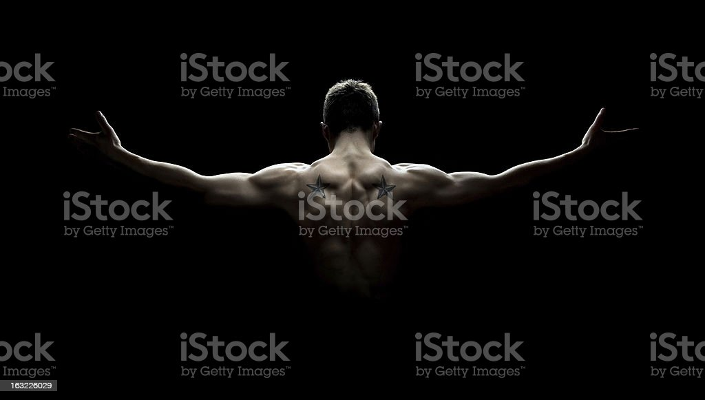 Muscular man's back royalty-free stock photo