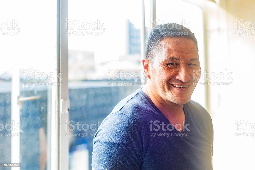 Muscular Maori Pacific Islander Man by a Window stock photo