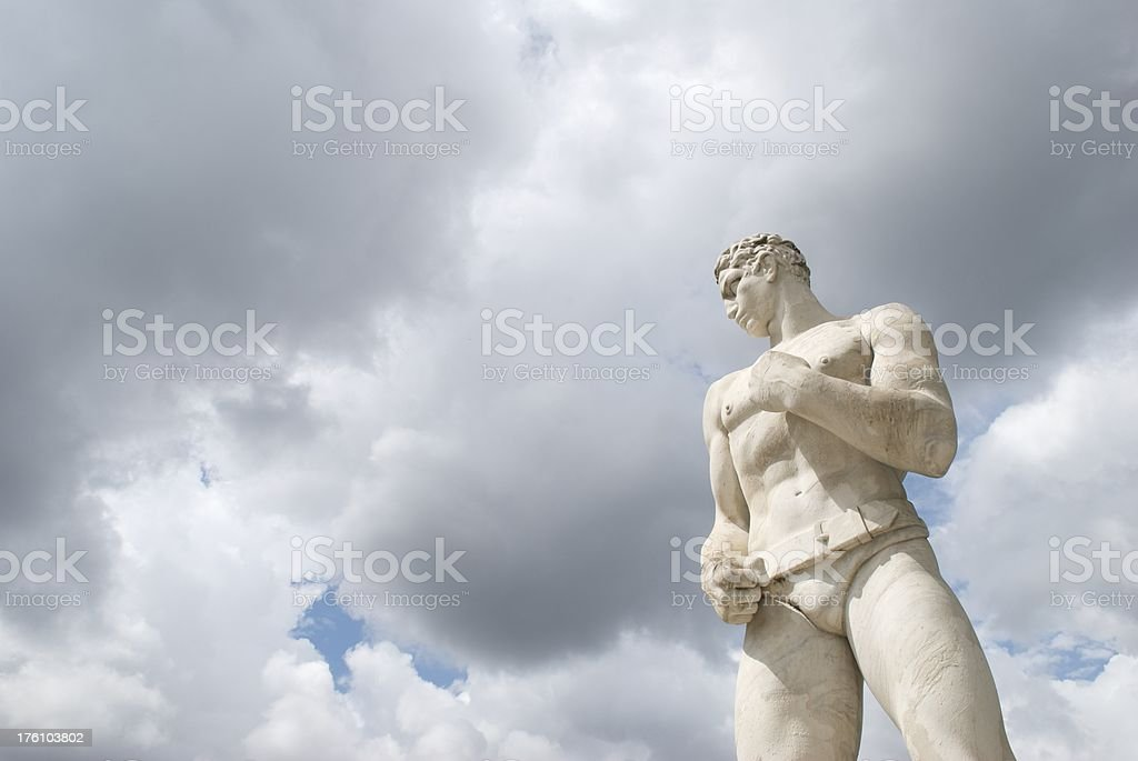 Muscular Marble Boxer Statue Moody Sky royalty-free stock photo