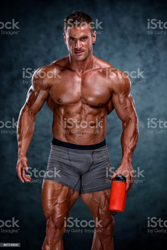 Muscular Men holding Sport Drink Bottle stock photo