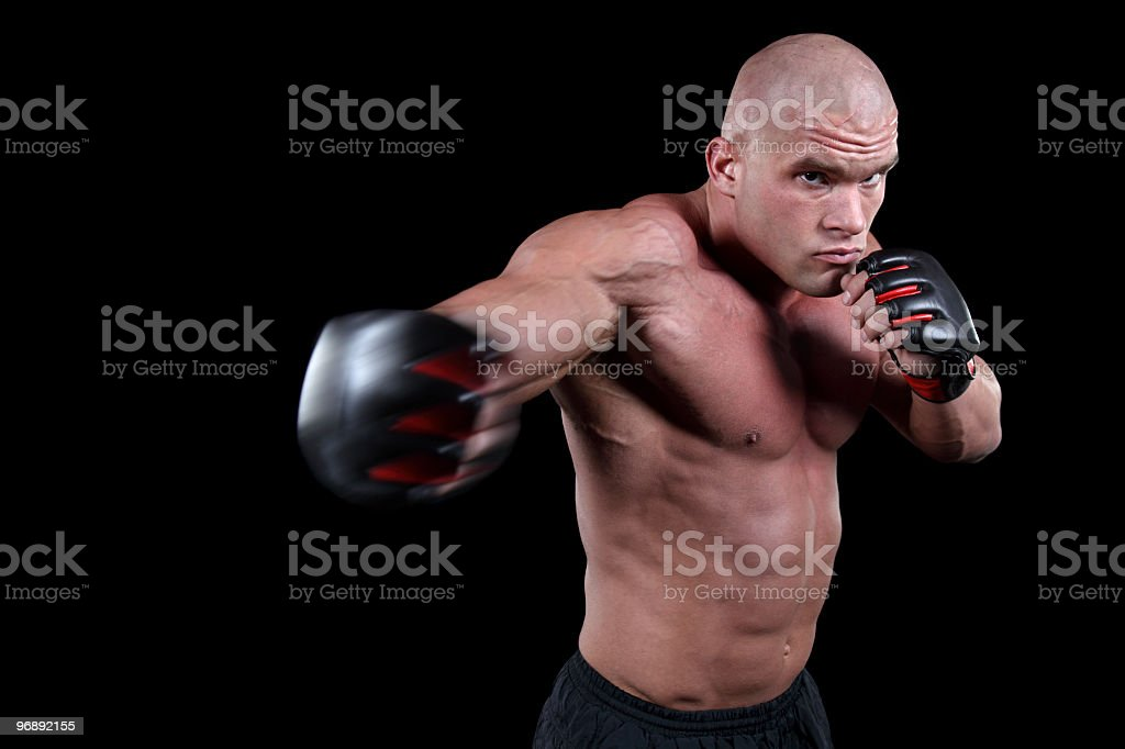 Muscular MMA fighter in action royalty-free stock photo