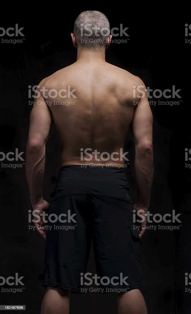 Muscular MMA - Mixed Martial Arts Fighter shot from behind royalty-free stock photo