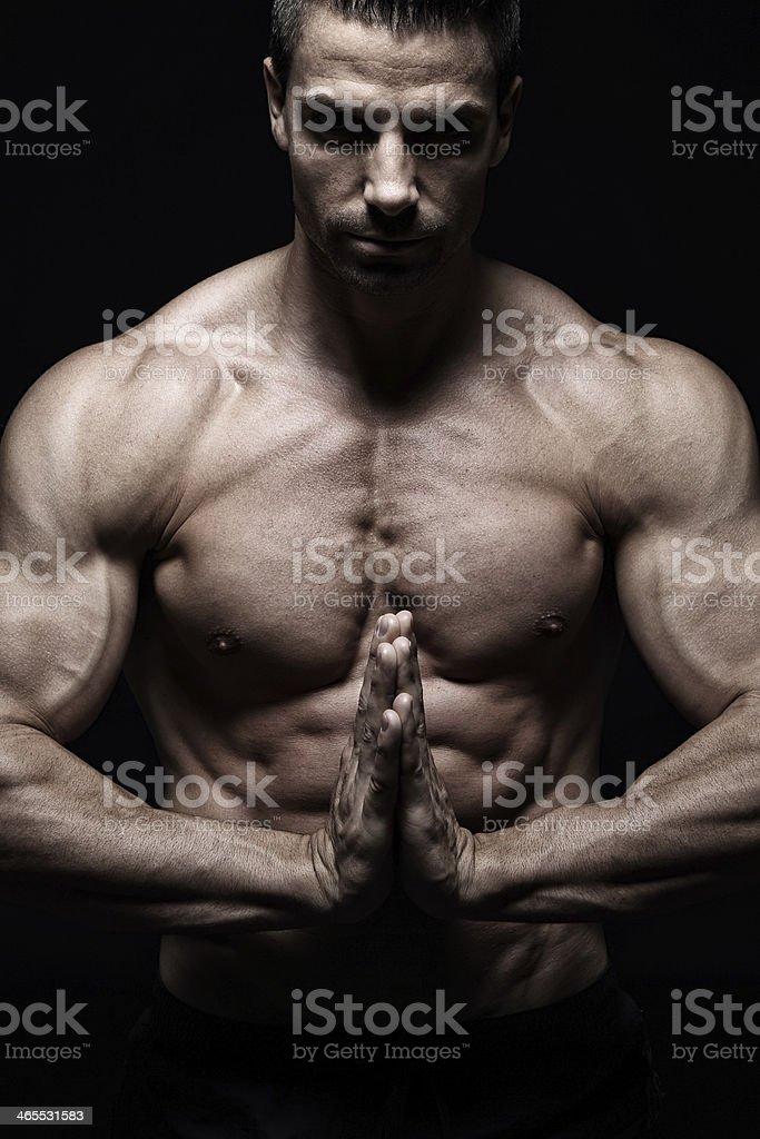 Muscular prayer royalty-free stock photo