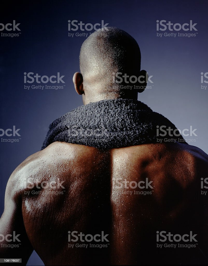 Muscular, Shirtless Man with Towel Around Neck royalty-free stock photo