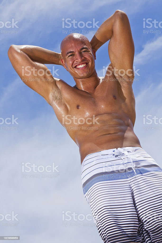Muscular shirtless multi-racial male with sky as background royalty-free stock photo