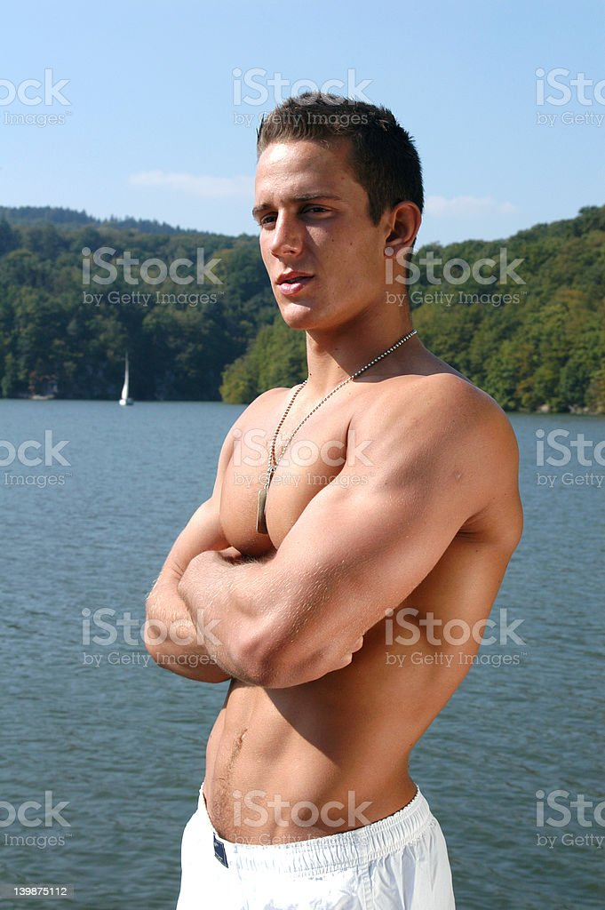 Muscular Teen at the Beach royalty-free stock photo