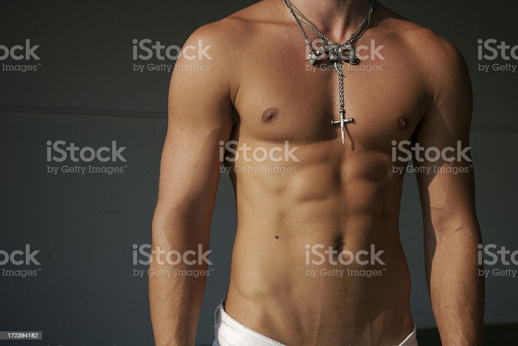 Muscular Torso Man with Bundle of Necklaces stock photo