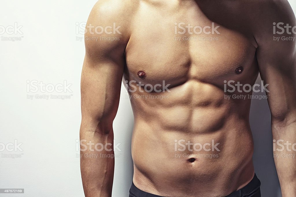 Muscular torso of young man stock photo