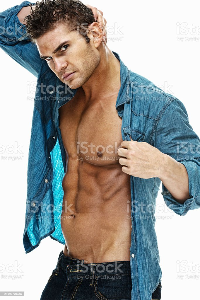 Muscular wet man posing stock photo