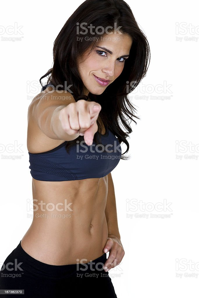 Muscular woman pointing to the viewer royalty-free stock photo