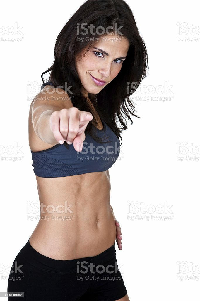 Muscular woman pointing to viewer royalty-free stock photo