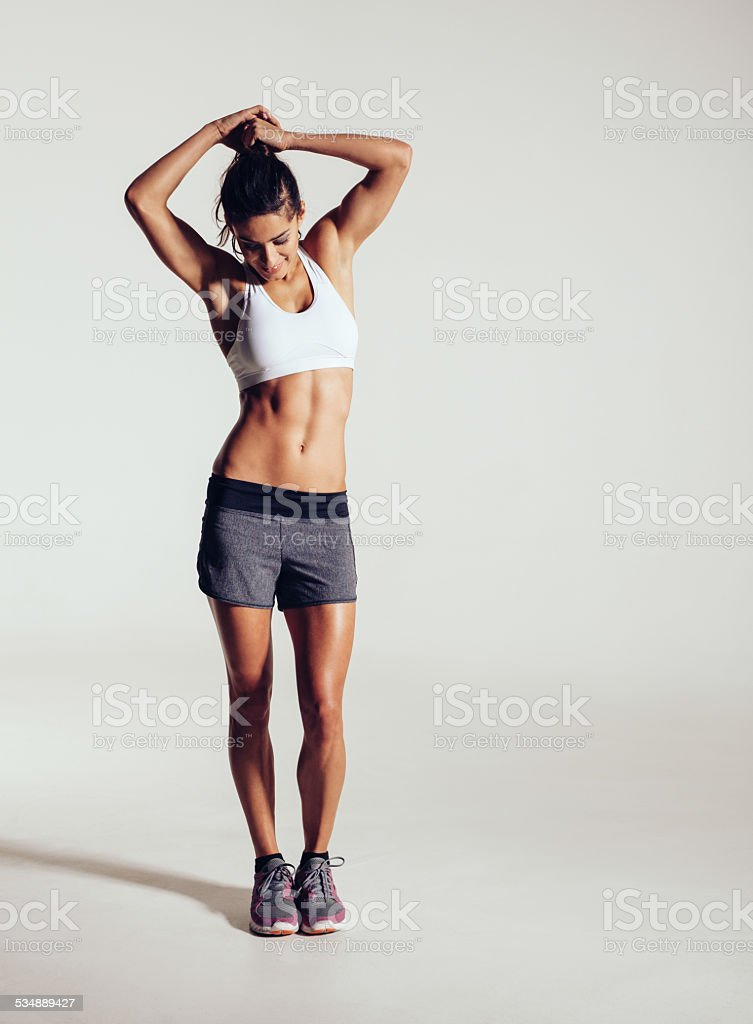 Muscular young fitness model in studio stock photo