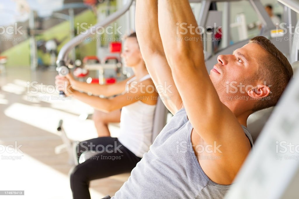 Muscular Young man at the gym royalty-free stock photo