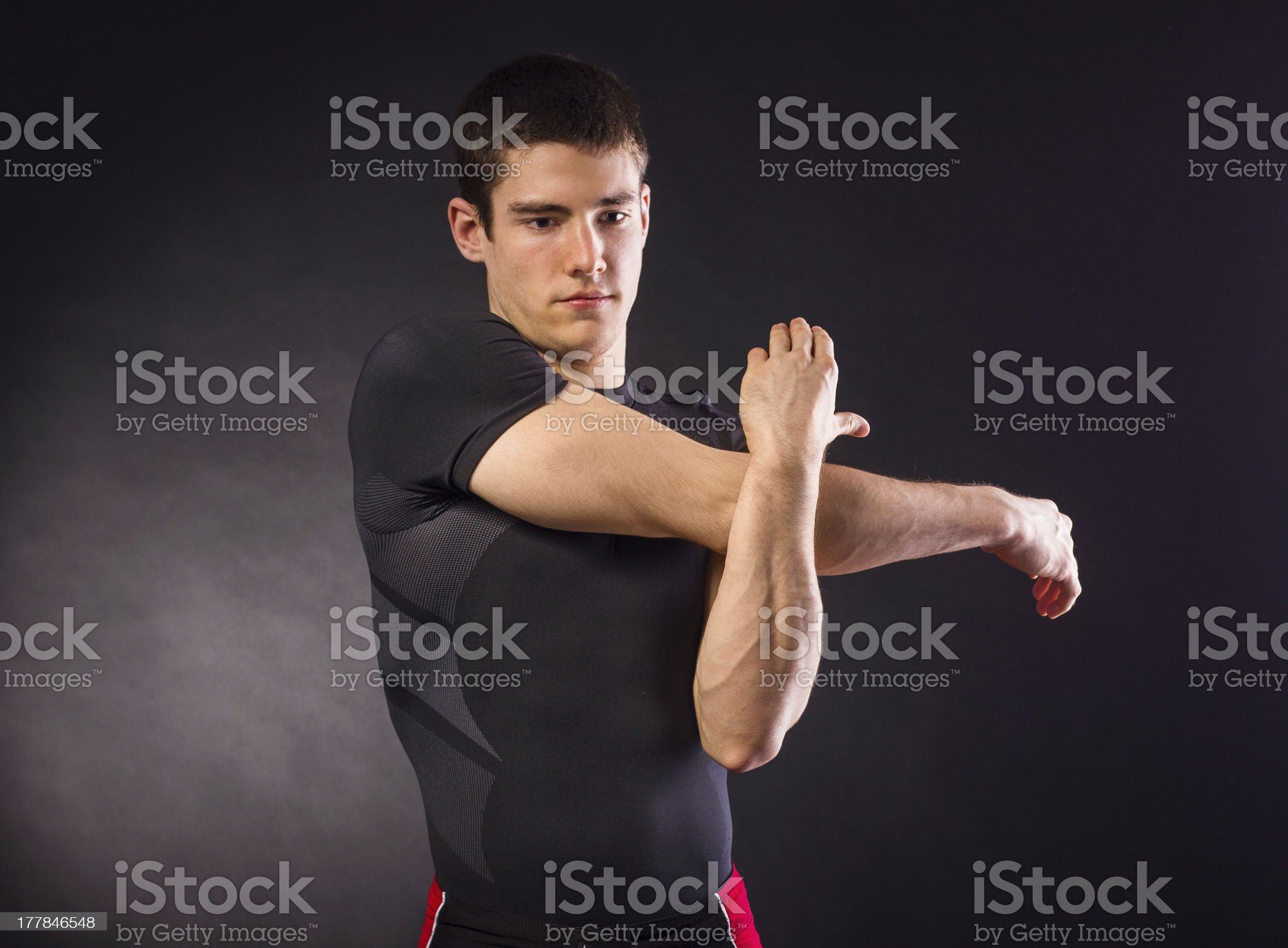 Muscular young man stretching royalty-free stock photo