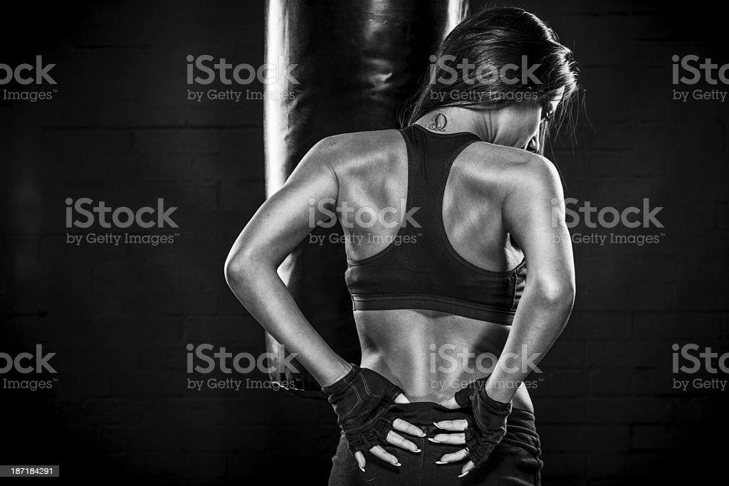 Muscular young woman posing stock photo