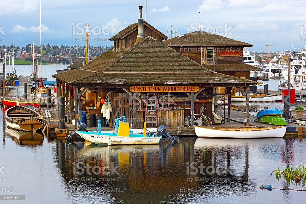 Museum on Lake Union with boats reflection before sunset stock photo