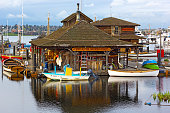 Museum on Lake Union with boats reflection before sunset