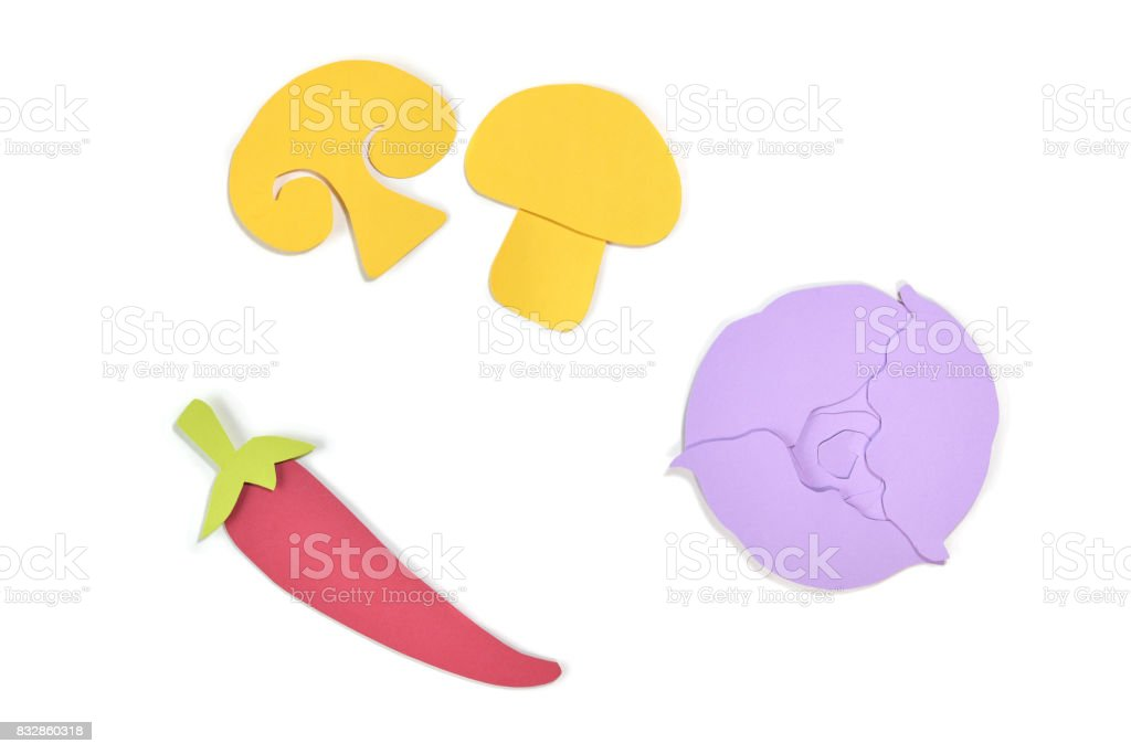 Mushroom, chili pepper and purple cabbage paper cut on white background stock photo