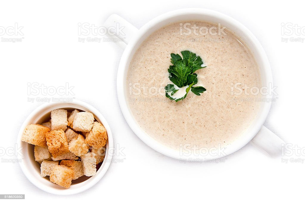 Mushroom cream soup isolated on white stock photo