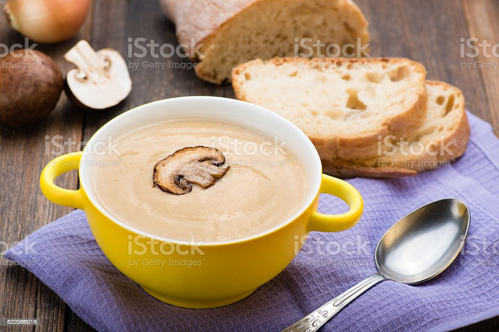 Mushroom cream soup on the wooden table. stock photo