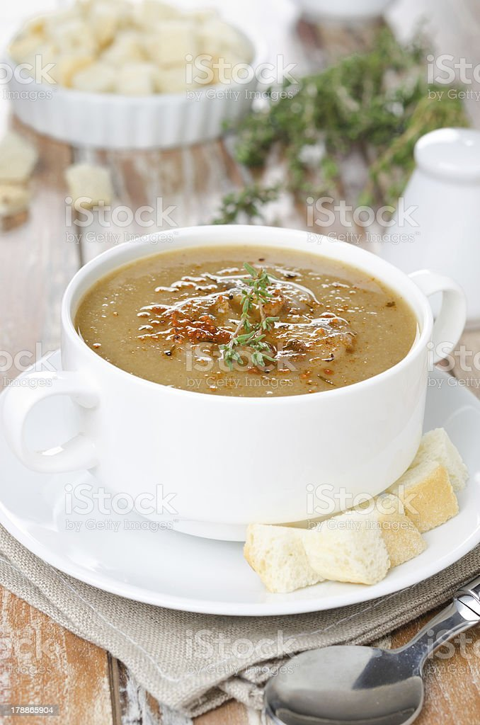 Mushroom cream soup with croutons and thyme in a bowl royalty-free stock photo
