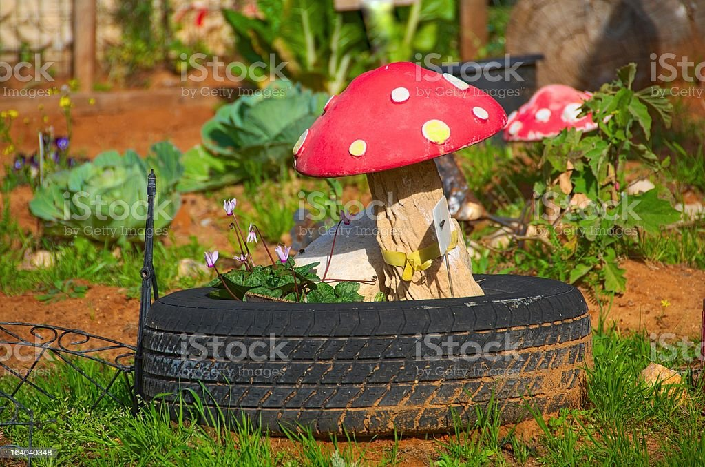 Mushroom Decoration in a Preschool Garden royalty-free stock photo