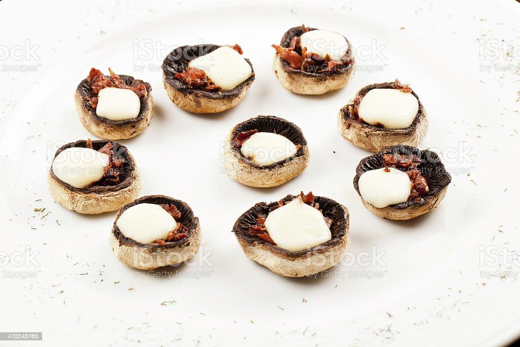 Mushroom gratin with mozzarella stock photo
