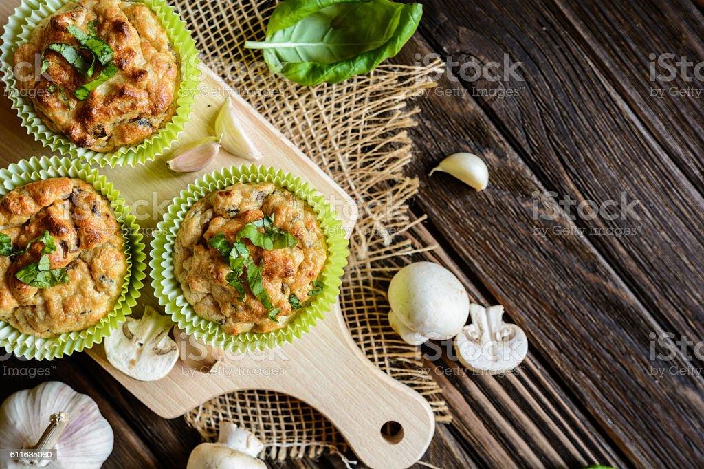 Mushroom muffins with basil stock photo