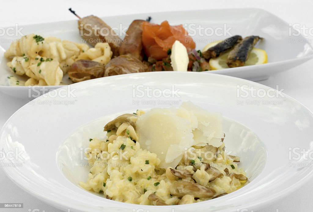 Mushroom Risotto and an Entree Tasting Plate royalty-free stock photo