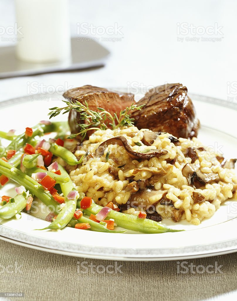 Mushroom risotto with steak tenderloin royalty-free stock photo