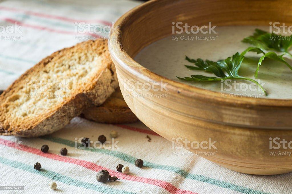 Mushroom soup puree in ceramic bowl with bread stock photo