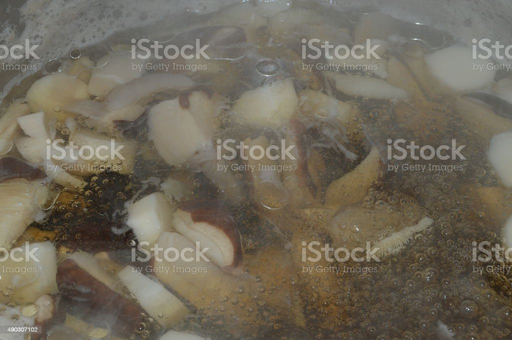 Mushrooms boiling royalty-free stock photo