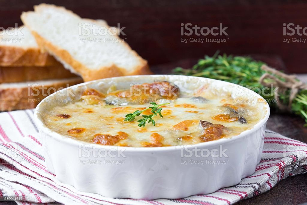 Mushrooms gratin with cream, cheese, French dish julienne stock photo
