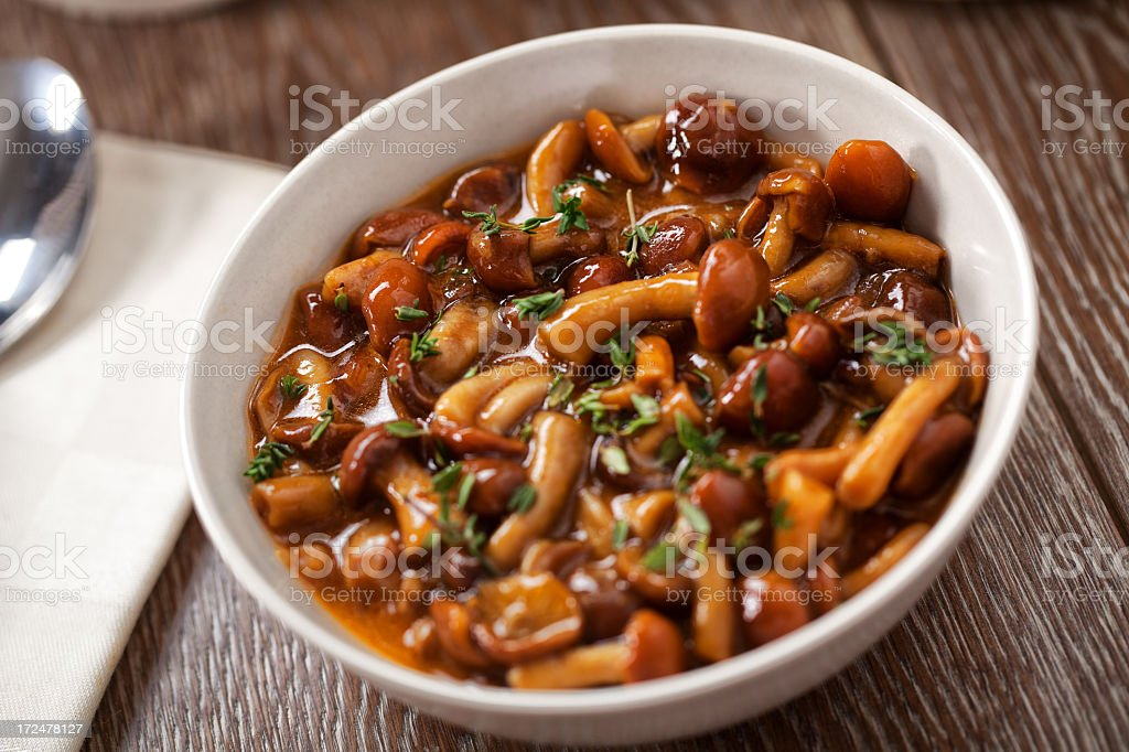Mushrooms in a bowl stock photo
