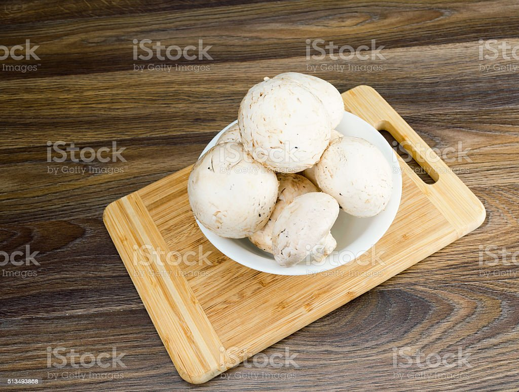Mushrooms in a white plate stock photo