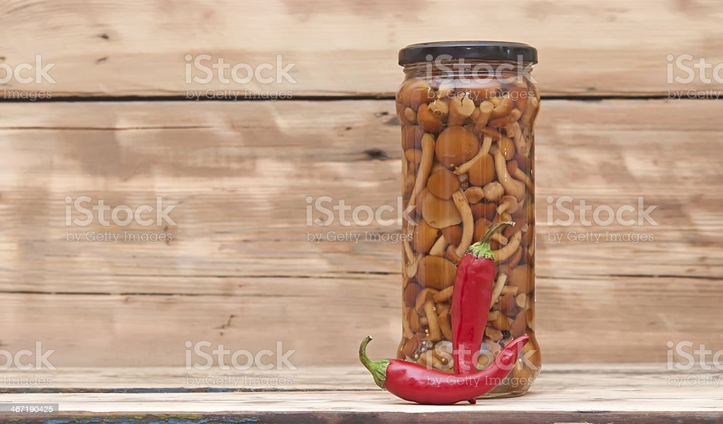 Mushrooms marinaded (agaric honey) in glass jar stock photo